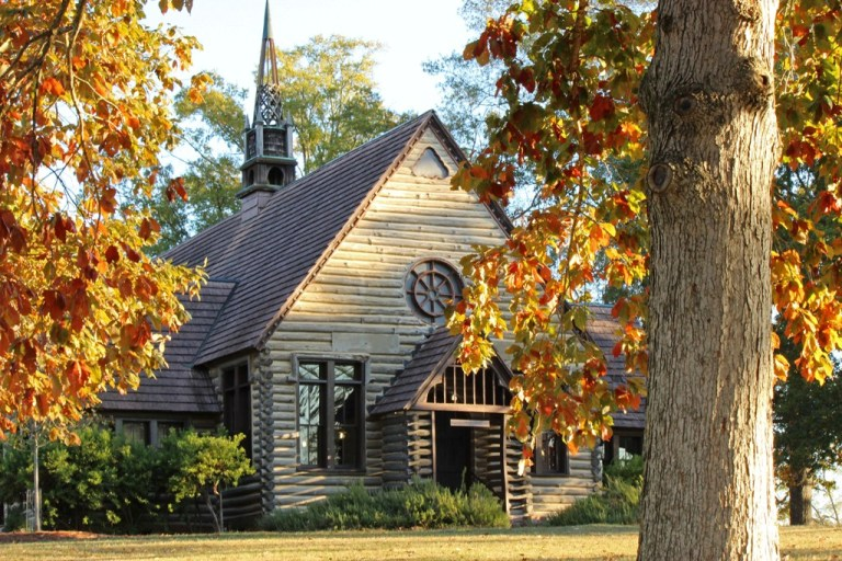 """The Barnwell Chapel was built in 1911.  This beautiful, rustic building is one of three campus chapels.  The college motto """"Not to be Ministered unto but to Minister"""" is engraved above the front door archway."""