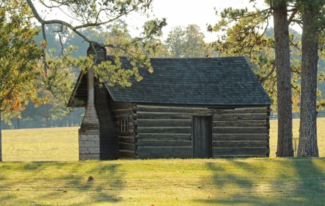 """The Cabin in the Pines is one of the oldest buildings on campus.  It is commonly called """"The Kissing Cabin"""" because in years past gentlemen were not allowed in the women's dorms and had to say their goodbyes here."""